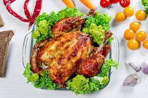 Whole baked chicken with vegetables and spices.Top view (Flip 2019)