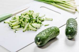 Whole fresh cucumbers and sliced on the kitchen Board. The concept of cooking (Flip 2019)