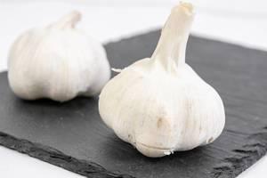 Whole Garlic on the black stone tray