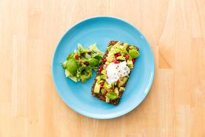 Whole Grain Bread with Avocado, Pomegranate and soy creame