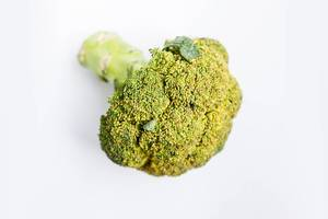 Whole head of broccoli on white background