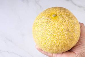 Whole Melon isolated above grey marble table (Flip 2019)