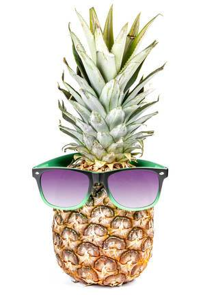 Whole raw fresh pineapple with sunglasses on white background. Summertime holiday concept (Flip 2020)