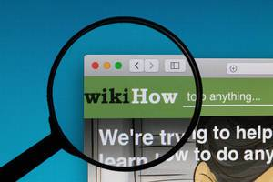 wikiHow logo under magnifying glass
