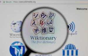 Wiktionary logo on a computer screen with a magnifying glass