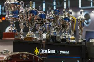 Winner cups / trophies  at the Caseking booth at German games fair Gamescom