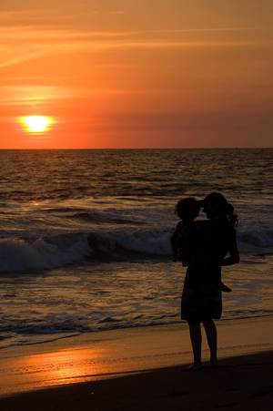 Woman and child enjoying sunset