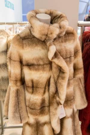 Woman fur coat in a store