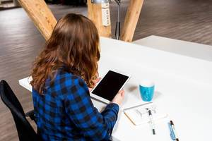 Woman in a Co-working space with her tablet