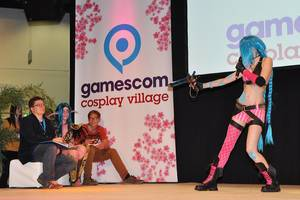 Woman in  a costume at the Cosplay village stage at German games fair Gamescom 2014