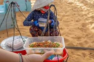 Woman selling Food at the Entrance of the Red Sand Dunes in Mui Ne  Flip 2019
