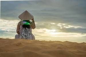 Woman watching the Sunset in the Red Sand Dunes of Mui Ne, Vietnam  Flip 2019