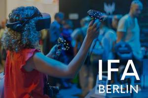"Woman with VR-Glasses on a Computer fair, next to picture title ""IFA BERLIN"""