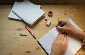Women writing on paper