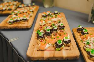 Wood Plates Of Salmon, Pork and Cream Canapes