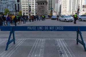 "Wooden blue barrier saying ""Police line - do not cross. Chicago Police Dept"""