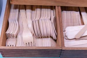 Wooden box with recyclable, environmentally friendly disposable cutlery for the reduction of plastic