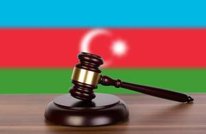 Wooden gavel and flag of Azerbaijan
