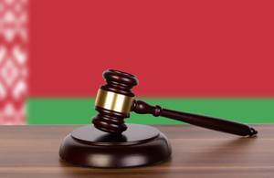 Wooden gavel and flag of Belarus