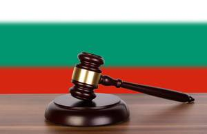 Wooden gavel and flag of Bulgaria