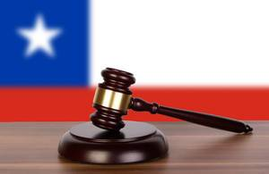 Wooden gavel and flag of Chile