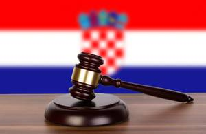 Wooden gavel and flag of Croatia