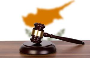 Wooden gavel and flag of Cyprus