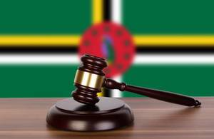 Wooden gavel and flag of Dominica