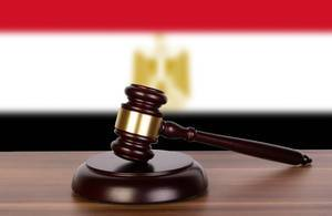 Wooden gavel and flag of Egypt