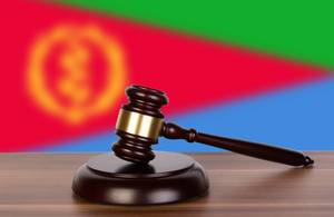 Wooden gavel and flag of Eritrea