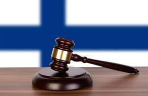 Wooden gavel and flag of Finland