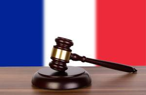 Wooden gavel and flag of France