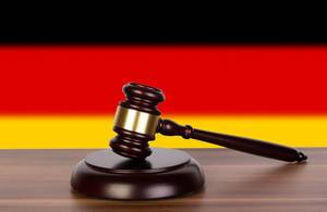 Wooden gavel and flag of Germany