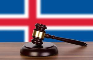 Wooden gavel and flag of Iceland
