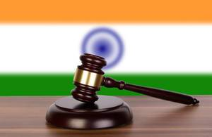 Wooden gavel and flag of India