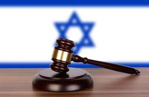 Wooden gavel and flag of Israel