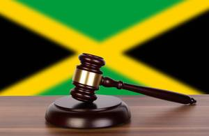 Wooden gavel and flag of Jamaica