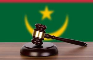 Wooden gavel and flag of Mauritania