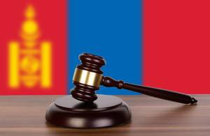 Wooden gavel and flag of Mongolia