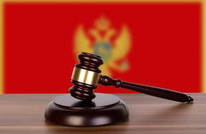 Wooden gavel and flag of Montenegro