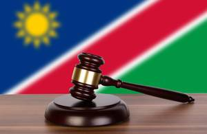 Wooden gavel and flag of Namibia