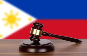 Wooden gavel and flag of Philippines