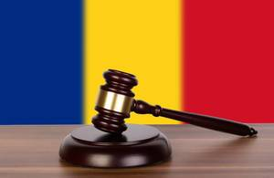 Wooden gavel and flag of Romania