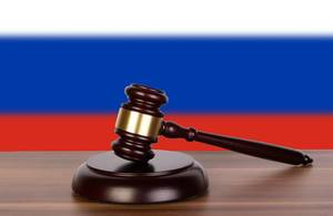 Wooden gavel and flag of Russia