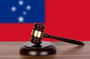 Wooden gavel and flag of Samoa