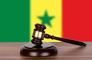 Wooden gavel and flag of Senegal