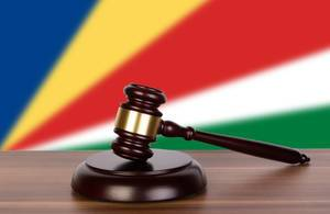 Wooden gavel and flag of Seychelles