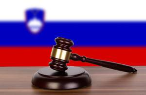 Wooden gavel and flag of Slovenia