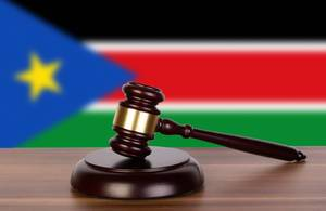 Wooden gavel and flag of South Sudan