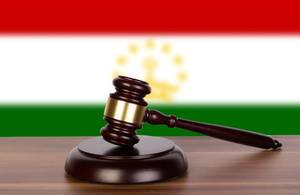 Wooden gavel and flag of Tajikistan